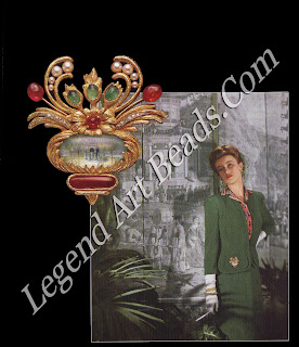 A fashion shot from Mum & Country (February 1943) portraying Mrs. Desmond FitzGerald wearing an urn brooch containing a miniature painting by Verdura.