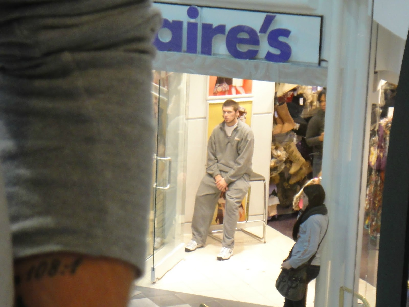 ... and seeing this man getting his ears pierced in pre-teen girl heaven: