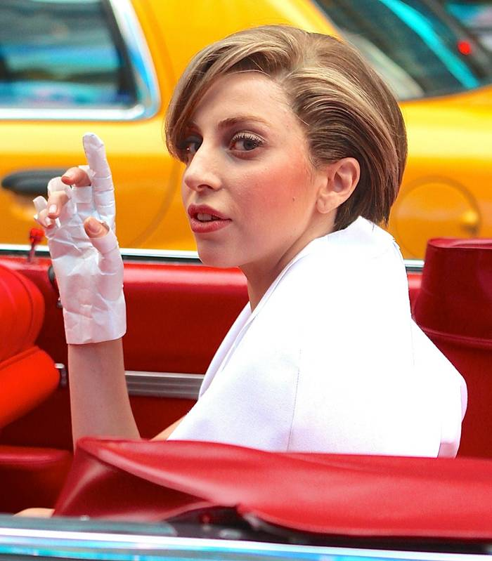 Lady Gaga Leaves her NYC Hotel in an Old School 1959 Cadillac