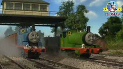 Thomas the train engine at a railway track-junction signal light steam train Percy the small engine