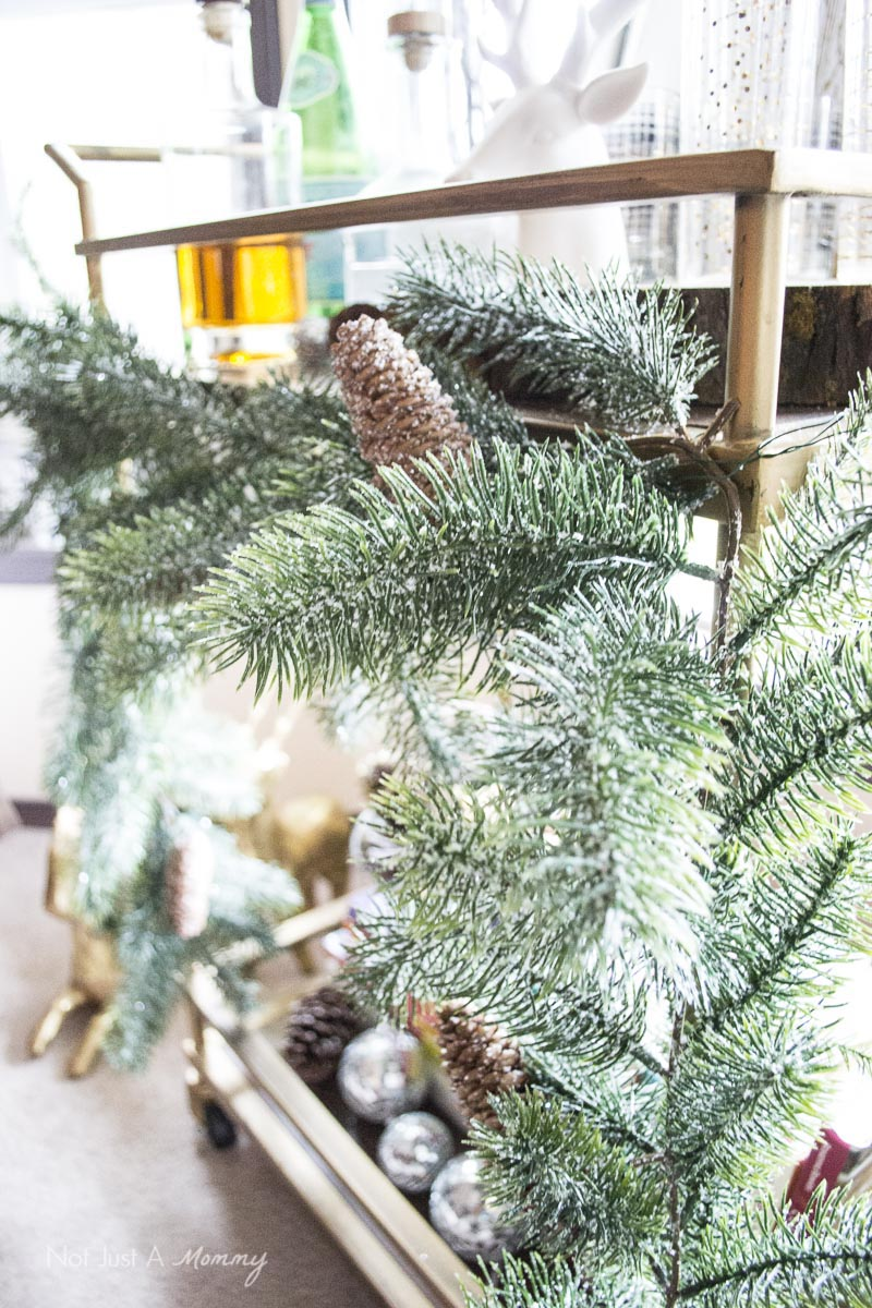 How To Decorate Your Home For The Holidays With Big Lots; trim your bar cart with a garland