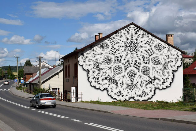 "NeSpoon is currently in Poland where she just finished working on a brand new ""bobbin laces"" mural somewhere on the streets of Bobowa."