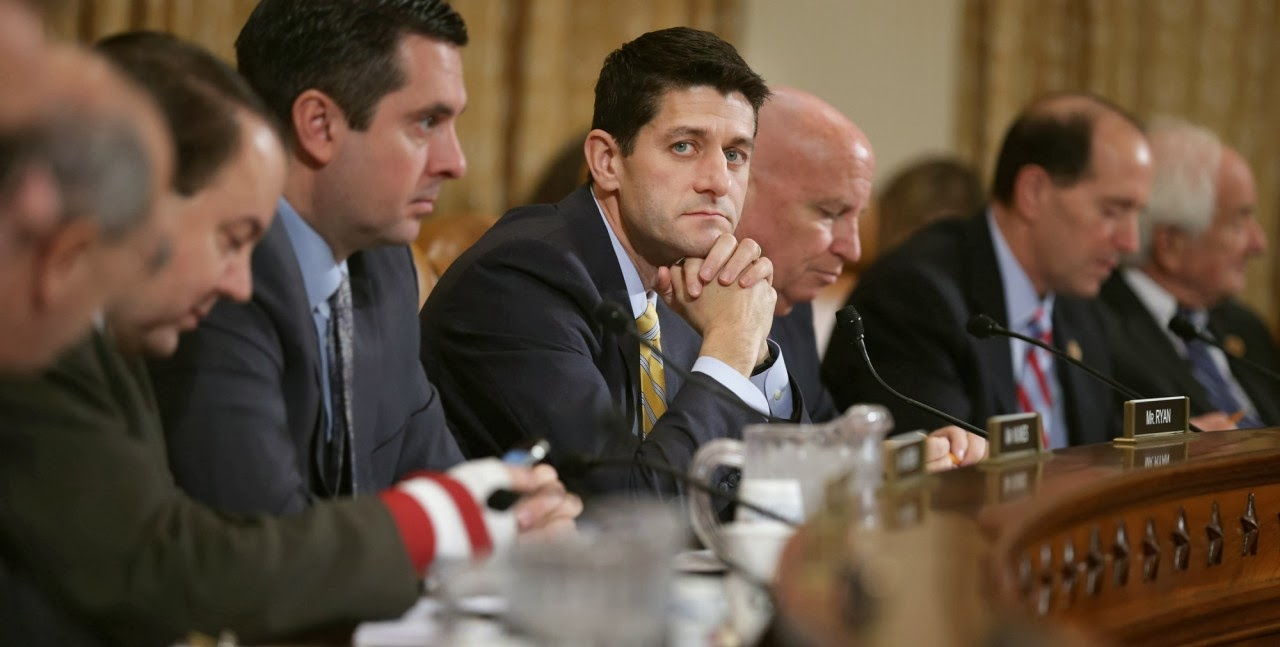 Photo of Rep. Paul Ryan during House Budget Committee hearing, looking at the camera