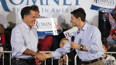 Rep. Paul Ryan of Wisconsin shakes hands with his running mate, presumptive Republican president nominee Mitt Romney.