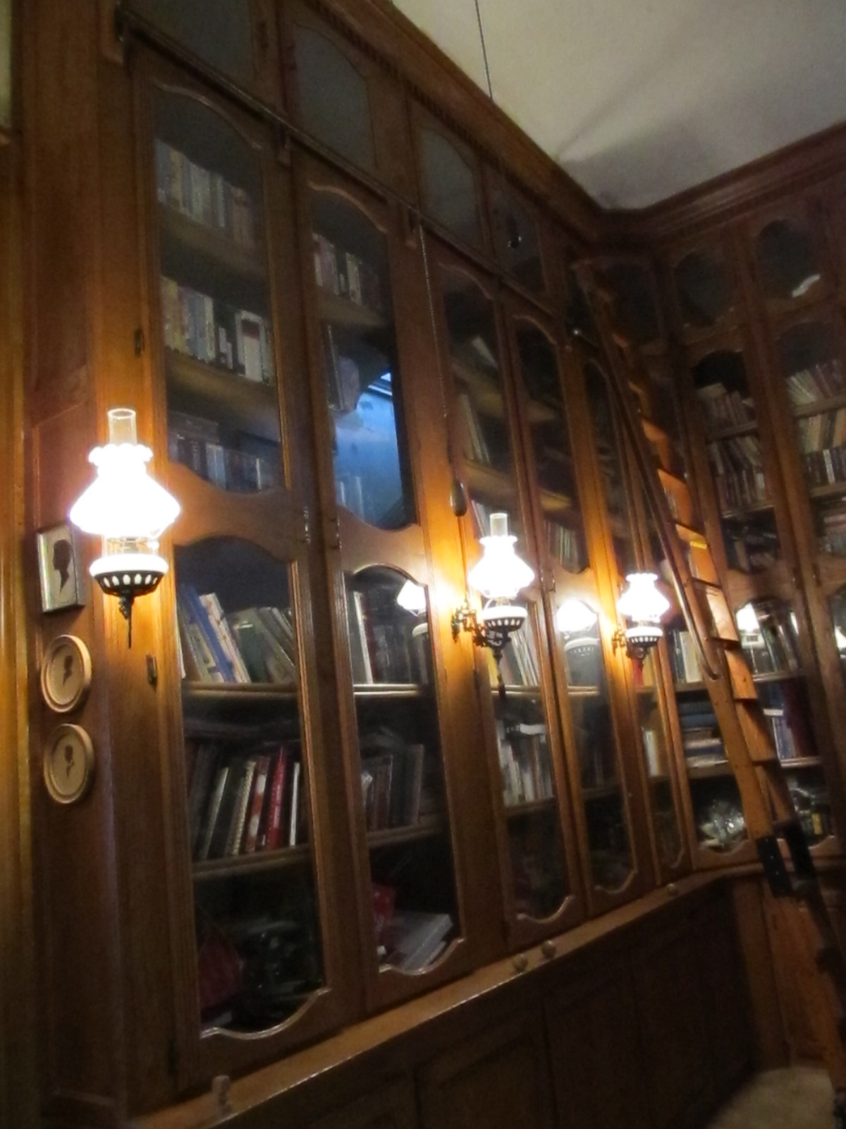 Floor to Ceiling Library with Glass Doors title=