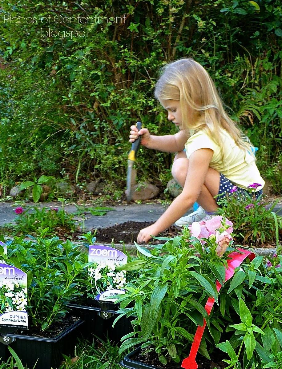 Miss E gardening