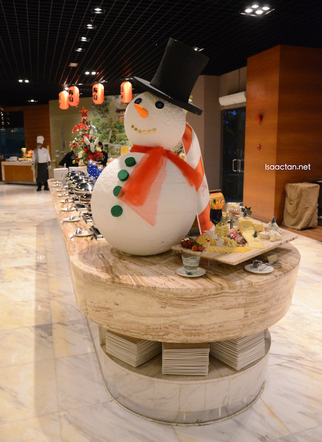 'Frosty' the snowman, guarding the buffet spread