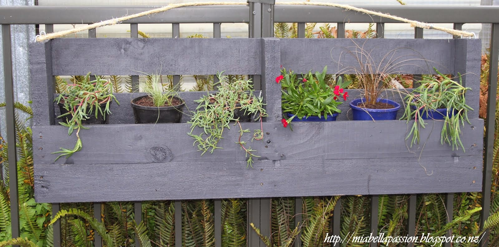 The DIY Pallet Hanging Planter Box: