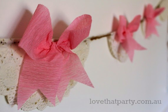 How to make your own budget party decorations! Bow and doily paper garland