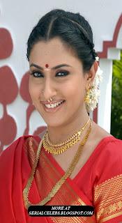 Malavika in red low hip saree