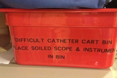 Red bin with sign, Difficult Catheter Cart