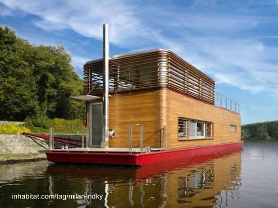 Casa barco de madera y metal diseño contemporáneo