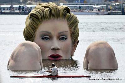 A Huge Mermaid Statue in Water
