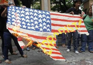 Stupid or Evil?  Libyans burn a US flag.