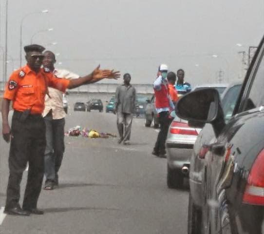 woman crushed death abuja