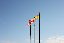 3 flags awaving.