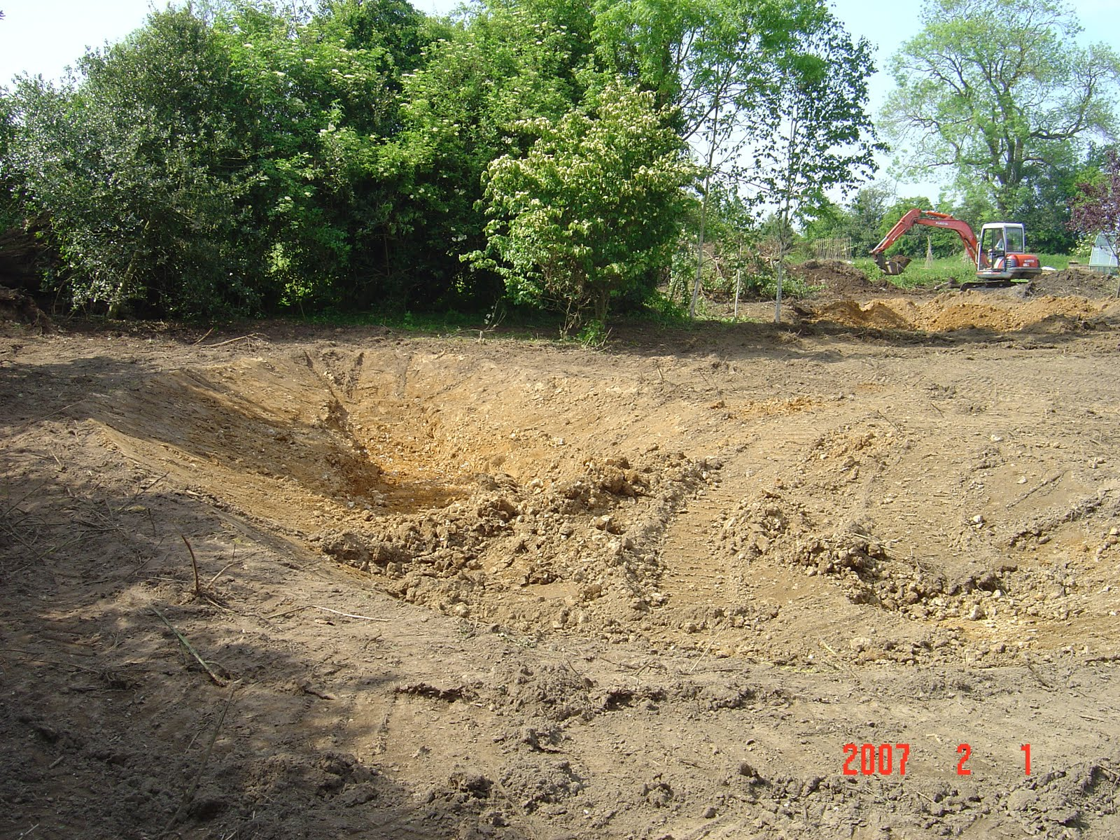 My work bricklaying patios and building large pond with for Building a large pond