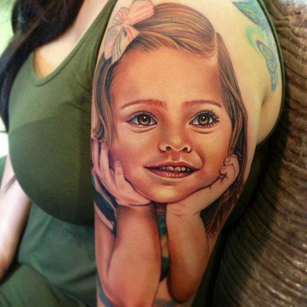 Realistic girl face tattoo on arm