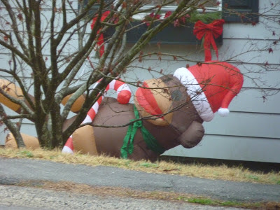 inflatable sock monkey with santa hat, fallen over