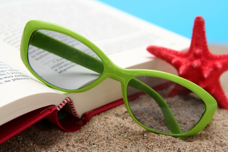 book and sun glasses