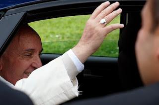 Pope's frayed cuffs