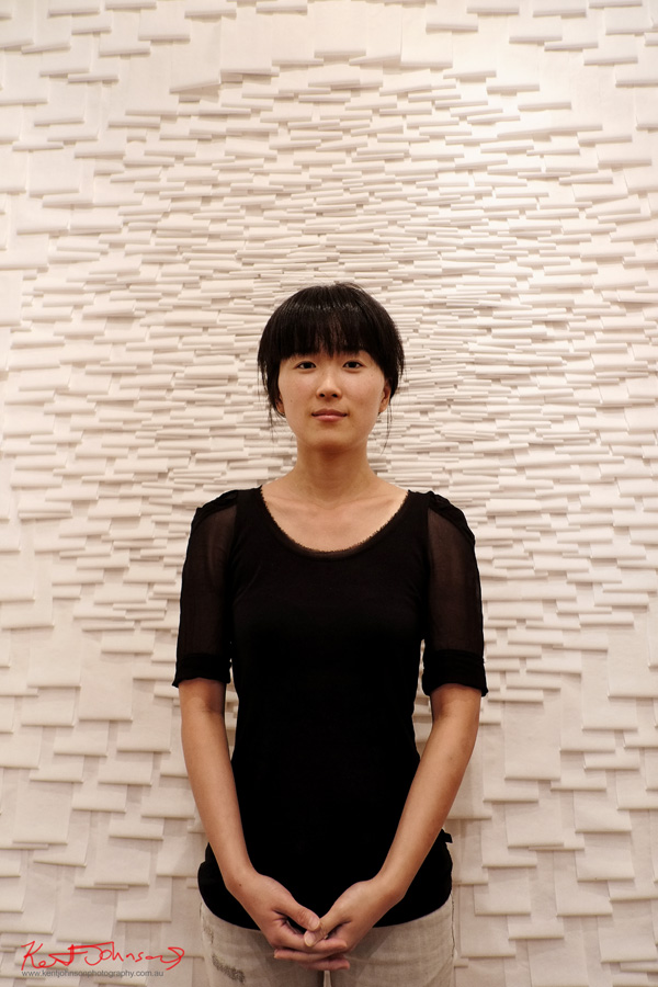 Rachel J Park artist portrait with installation 'I AM' Accelerator Gallery. Photo by Kent Johnson. Fuji X-Pro1
