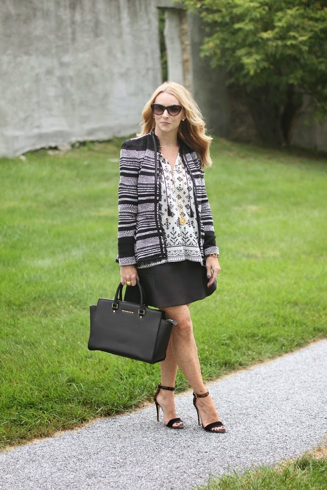joie silk top, jcrew fluted skirt, club monaco leopard heels, saint laurent sunglasses, michael kors handbag, julie vos coin necklace