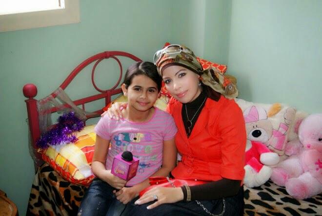 مع الفنانة منة عرفة عام 2010