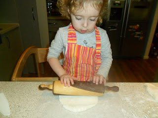 Rolling out the dough for homemade pizza recipe