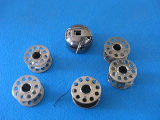 http://repairmanuals.ecrater.com/p/7425115/singer-class-15-bobbin-case-88-90-91-125
