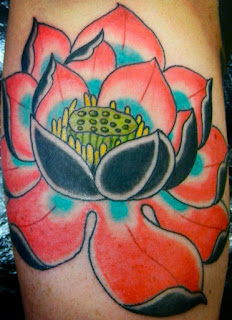 Tattoo of a large pink and blue lotus flower by Tattoo artist Mark Stewart for Triumph Tattoo