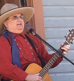 Western Cowboy Singer and Yodeler, Lonesome Ron, Buys Cabin in Exchange for Giving Guitar Lessons