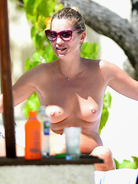 Kate Moss Sunbathing Topless On A Beach In Jamaica