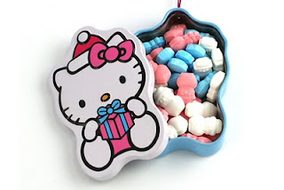 Hello Kitty Christmas snowman candy treats in tin ornament