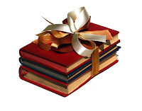 stack of books tied with a golden bow