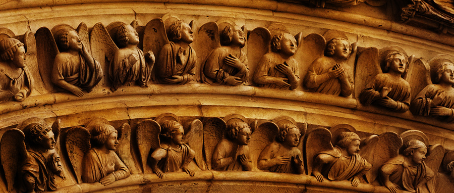 Detail of carving. Notre Dame Entrance one - Photograph by Tim Irving