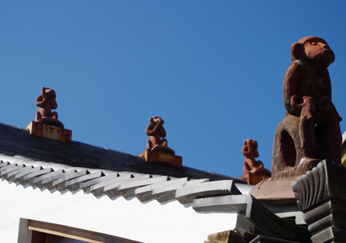 Monkey roof statues in Nara.