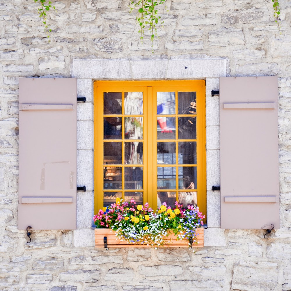 Charming yellow window trim in Quebec city - Travel ideas