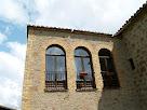 Eixida de la casa Guardiola en la façana de migdia