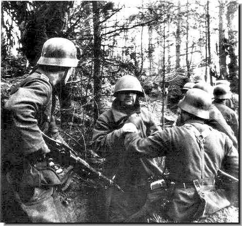Invading German soldiers capture Red Army soldier