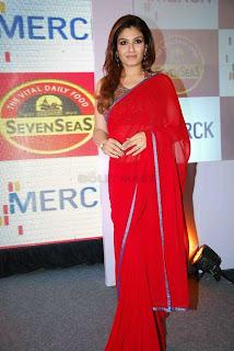 WWW.BOLLYM.BLOGSPOT.COM Bollywooed Actress Raveena Tandon in Red Saree at Seven Seas press meet at Taj el Picture Stills Gallery 0011.jpg