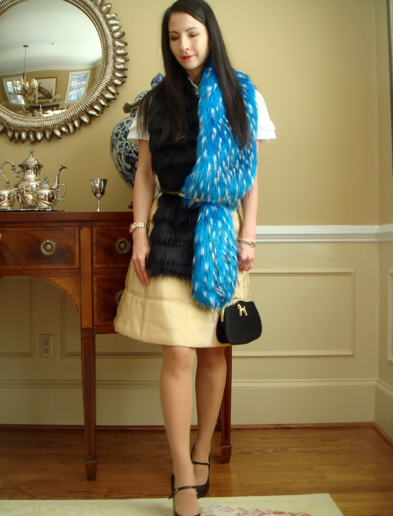 Fur scarf belted over quilted skirt and short sleeved button down.