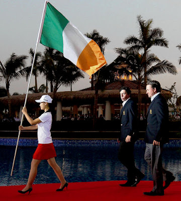Graeme McDowell, right, and Rory McIlroy walk behind the Tricolour during the Opening Ceremony of the World Cup at the Mission Hills' Blackstone Course in Hainan Island, China, last year (Photo: Getty)