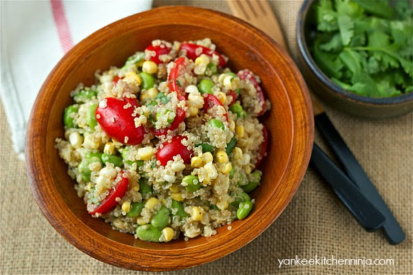quinoa salad with fresh corn, edamame and tomatoes in a lime vinaigrette