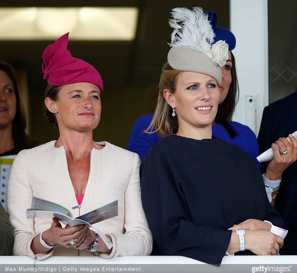 Zara Phillips Style - Dolly Maude and Zara Phillips watch the racing as they attend day 3 'Grand National Day' of the Crabbie's Grand National Festival at Aintree Racecourse