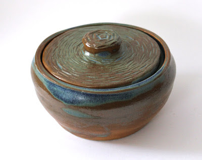 carved and glazed pottery covered pot