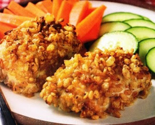 Picture of Crispy Ranch Chicken on a white plate with carrots and cucumbers.