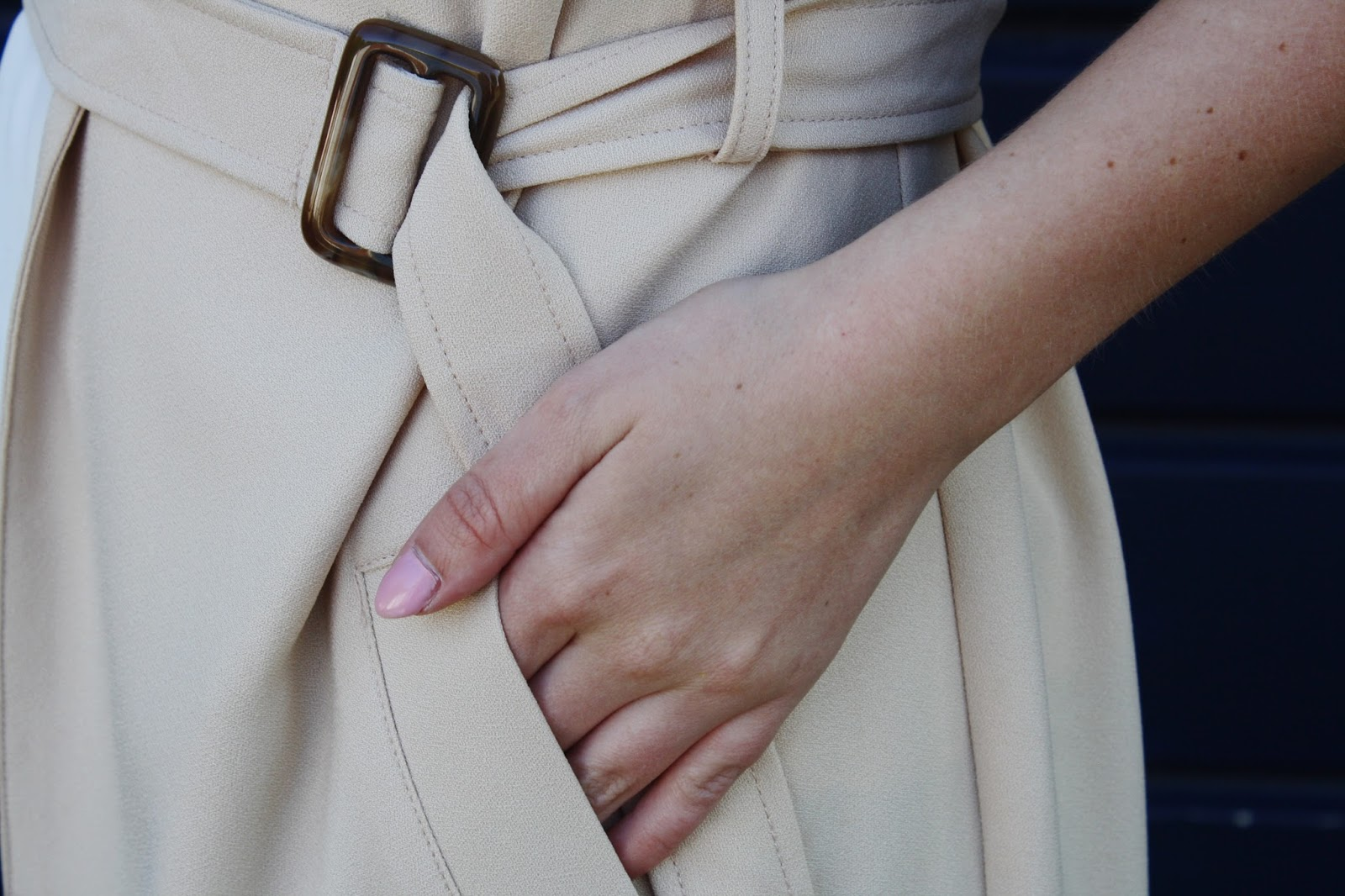 Close up of D ring detail of trench coat belt
