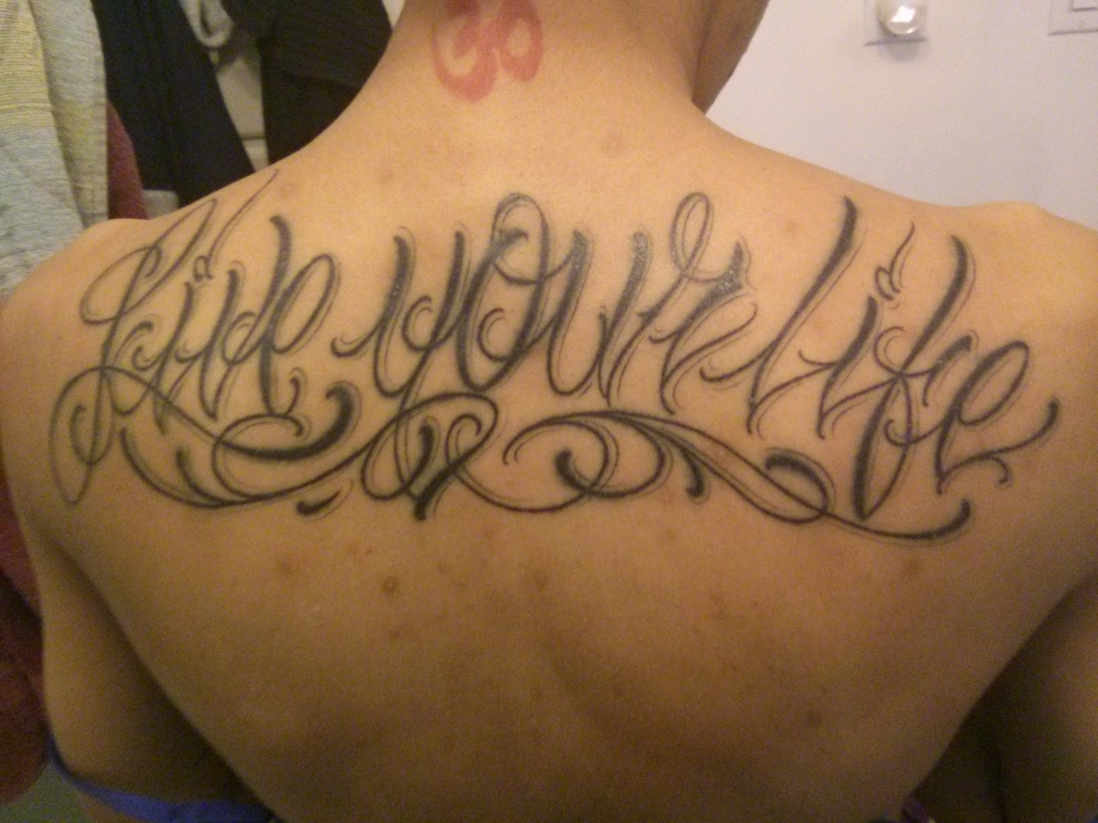"my new ink ""live your life"" tattoo on back copyright 2014 by OneQuarterMama.ca"