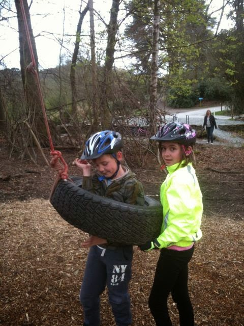 helpful big sister with the tyre swing
